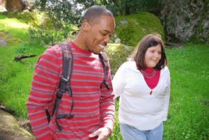 Picture of a man and young visually impaired female smiling